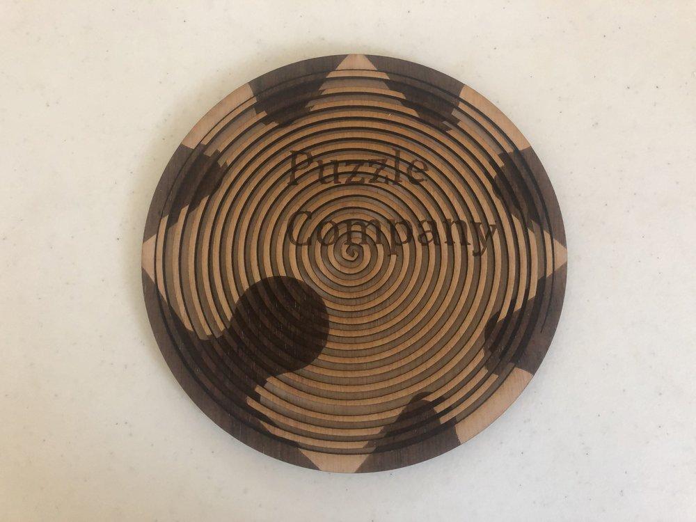 Puzzle Company wooden logo.JPG