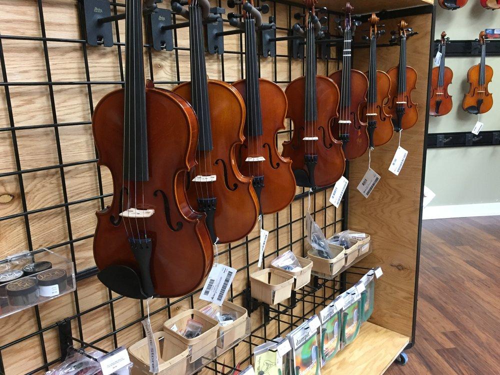 sizing violins.JPG