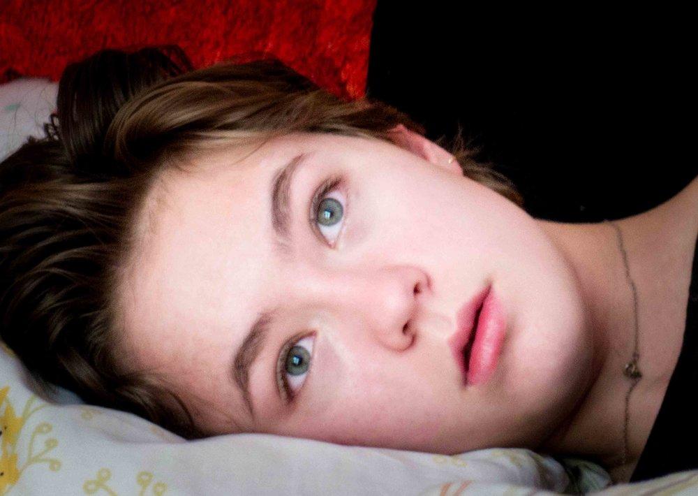 Amelia-liying-down-eyes-cast-away.-HjjjjERO.jpg
