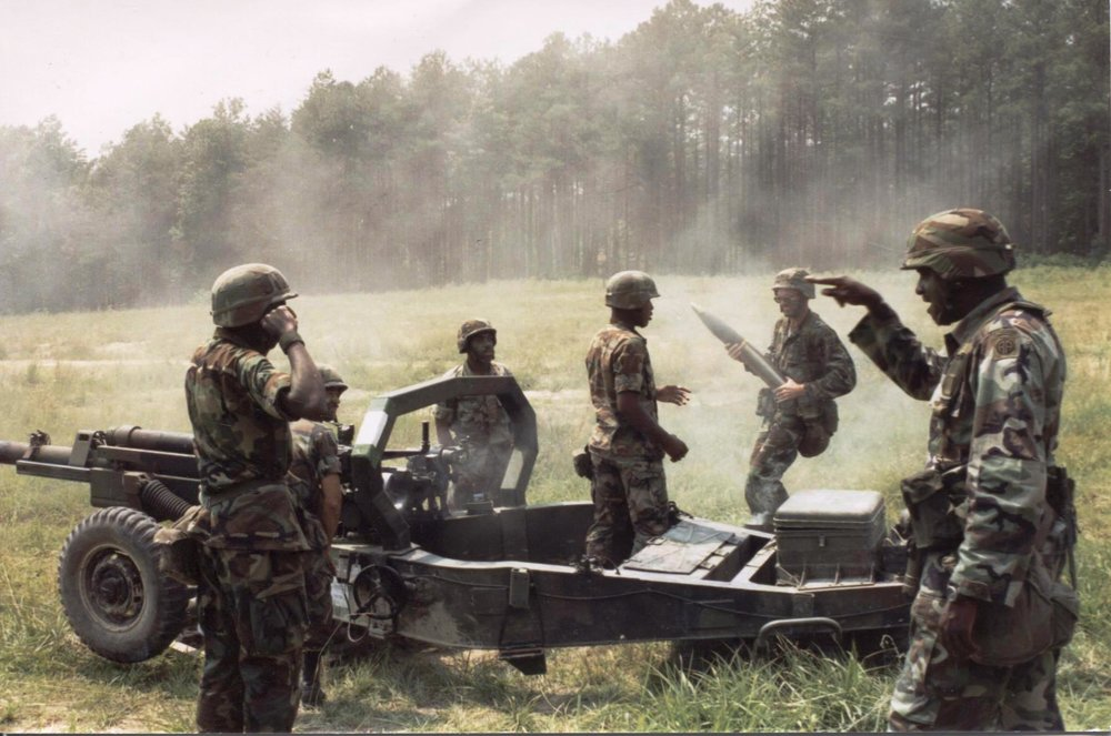 Military Service - Staff Sergeant Layne (far left) supervises a 105-howitzer crew during training exercises held at Fort Bragg, North Carolina.