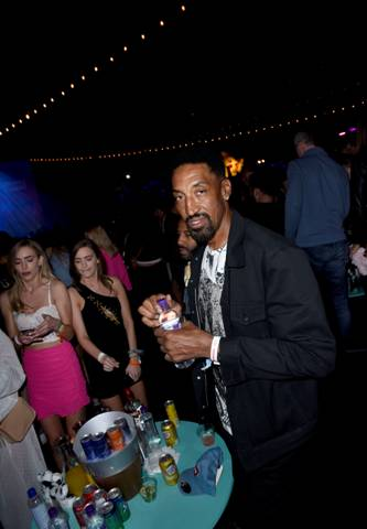 Basketball legend Scottie Pippen and friends sip Penta Water in VIP at Levi's Brand Presents Neon Carnival with Bondi Sands and POKÉMON: Detective Pikachu on April 13, 2019 in Thermal, California.