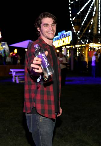 Breaking Bad Star RJ Mitte stays hydrated with Penta Water Levi's Brand Presents Neon Carnival with Bondi Sands and POKÉMON: Detective Pikachu on April 13, 2019 in Thermal, California.