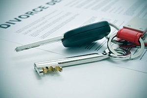 house-and-car-keys-on-top-of-a-divorce-decree-document1.jpg