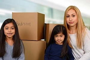 Divorced Mother and Her Two Daughters Ready to Relocate After Packing
