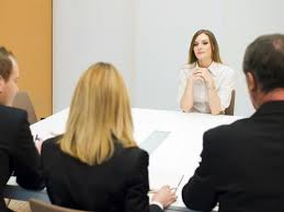 people-sitting-around-a-table-working-on-the-meditation-of-a-divorce-settlement.jpg