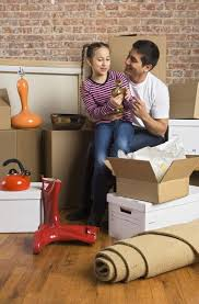 Divorced father and his daughter unpacking after a relocation