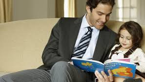 Father spending reading time with daughter