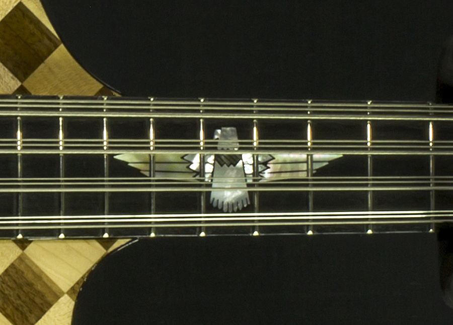 The inlay at the 12th fret is a very cool Thunderbird.