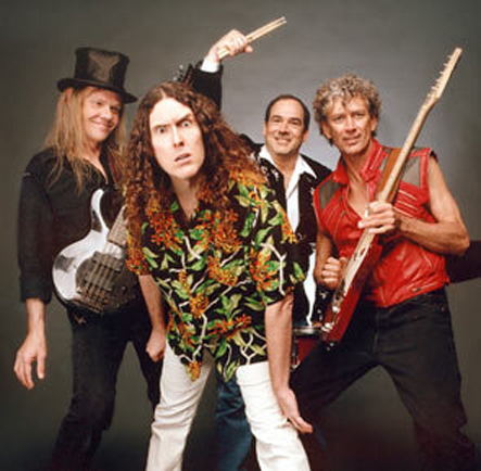 "Another image from Weird Al Yankovic's ""Poodle Hat"" album with Stephen Jay and with his Dean Rhapsody 12-string bass."