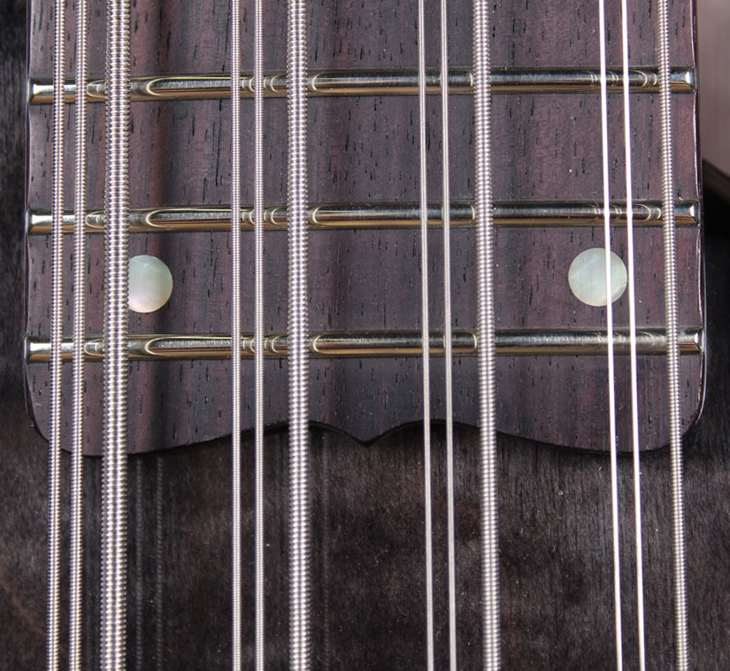 The Rhapsody 12 incorporates relatively wide spaces between the string courses.