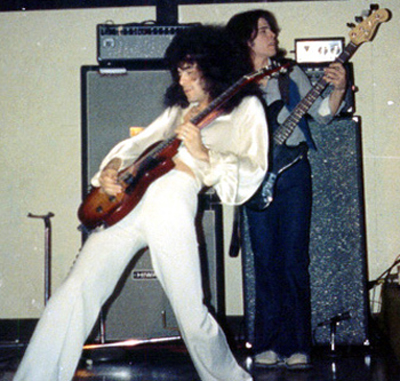 Pete Comita on guitar with Jon Brant playing in the band d'Thumbs.