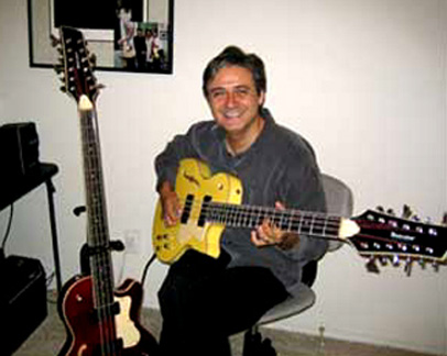 Rob Martinez - Rob is shown with two of his Waterstone 12-string basses. The song 'Every Sunday' from the Xaltar album was included in the 'Overkill Is Just Enough' 12-string bass compilation album released in 2008.