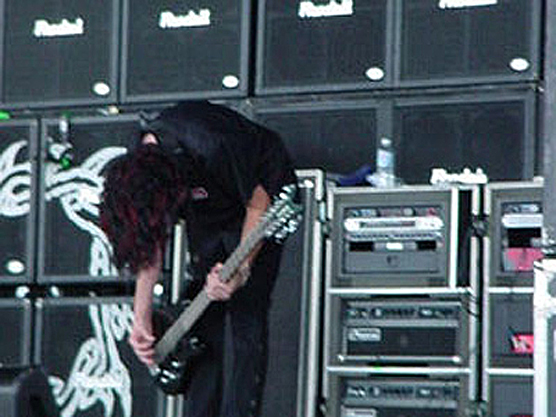 Tim King on stage at Ozzfest 2002 with his Hamer CH-12 12-string bass.