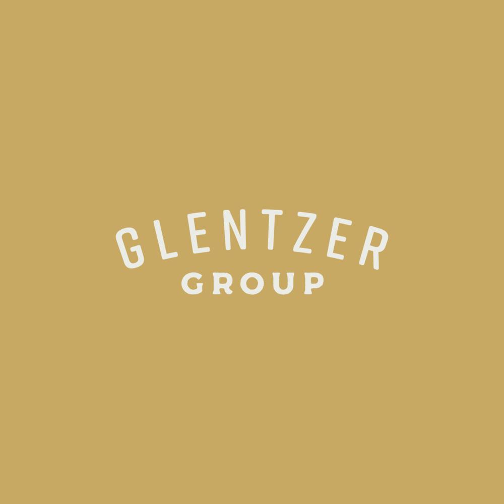 GlentzerGroup_Block_Logo_Mustard-White.png