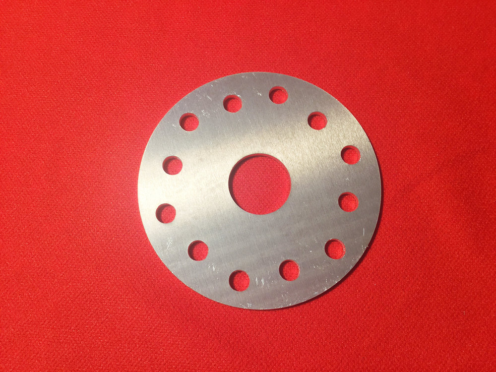 "Crush or Face Plate - 3/16"" aluminum plate. One-inch center pilot hole. Six, 5/16"" or 8mm holes on standard Rotax 75mm bolt circle and 2 3/4"" bolt circle."