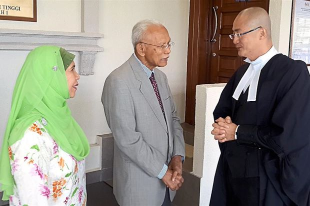 Good news: Ismail (centre), wife Rohani Yusoff and counsel Foong after the High Court proceeding. — Bernama