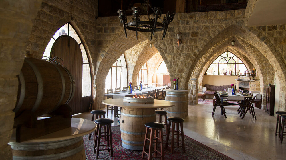 Indoor Venue   We offer an authentic Lebanese ambiance in our indoor venue, where the arcades and the fire place are guaranteed to create a warm and charming atmosphere.   Capacity: approx. 100 Seated Guests