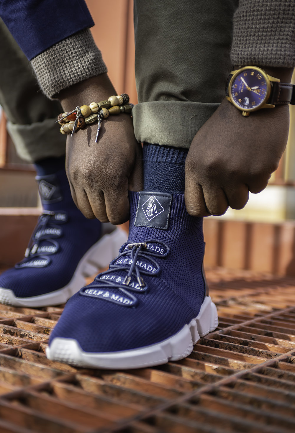 Exclusive - Self-Made Custom Menswear Founders, Brandon and Aime, personally designed this founders approved navy blue and white color edition shoe. Self-Made will only produce a limited amount of The Debuts. These shoes are very rare and exclusive so claim yours now.