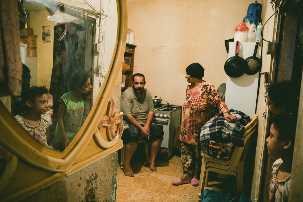 A family gathers in the kitchen of their small home in the Shatila refugee camp.
