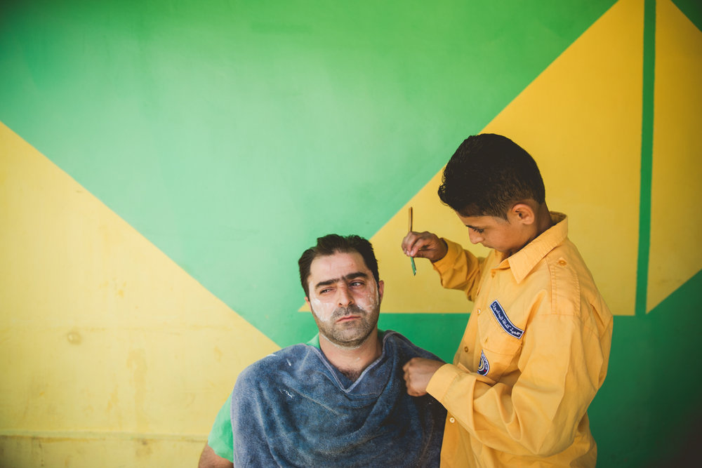 Yasar Taha, a 15-year-old Syrian refugee, works illegally as a barber as well as in a local restaurant while attempting to go to school. If he stops working his family might lose the tent they live in, as they rely on his income along with his father's to pay rent.