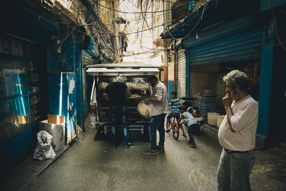 A bread truck unloading on one of the narrow streets of the Shatila camp.