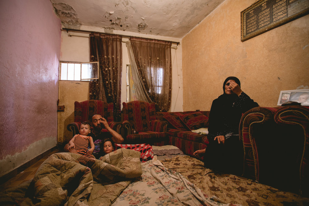 Another perspective of Amal's home. Here she sits in the single room with her son and grandchildren.