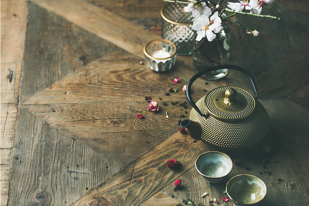 asian-golden-iron-teapot-cups-candles-and-almond-PM4D6BS.jpg