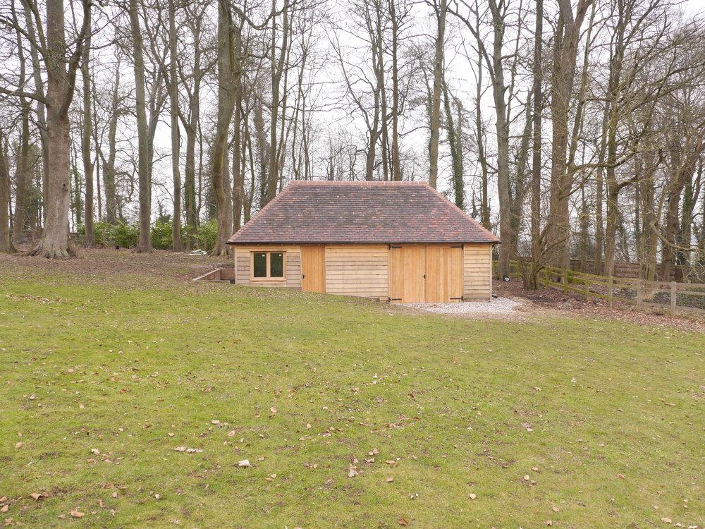 Oak frame garage, timber garage, timber garden store