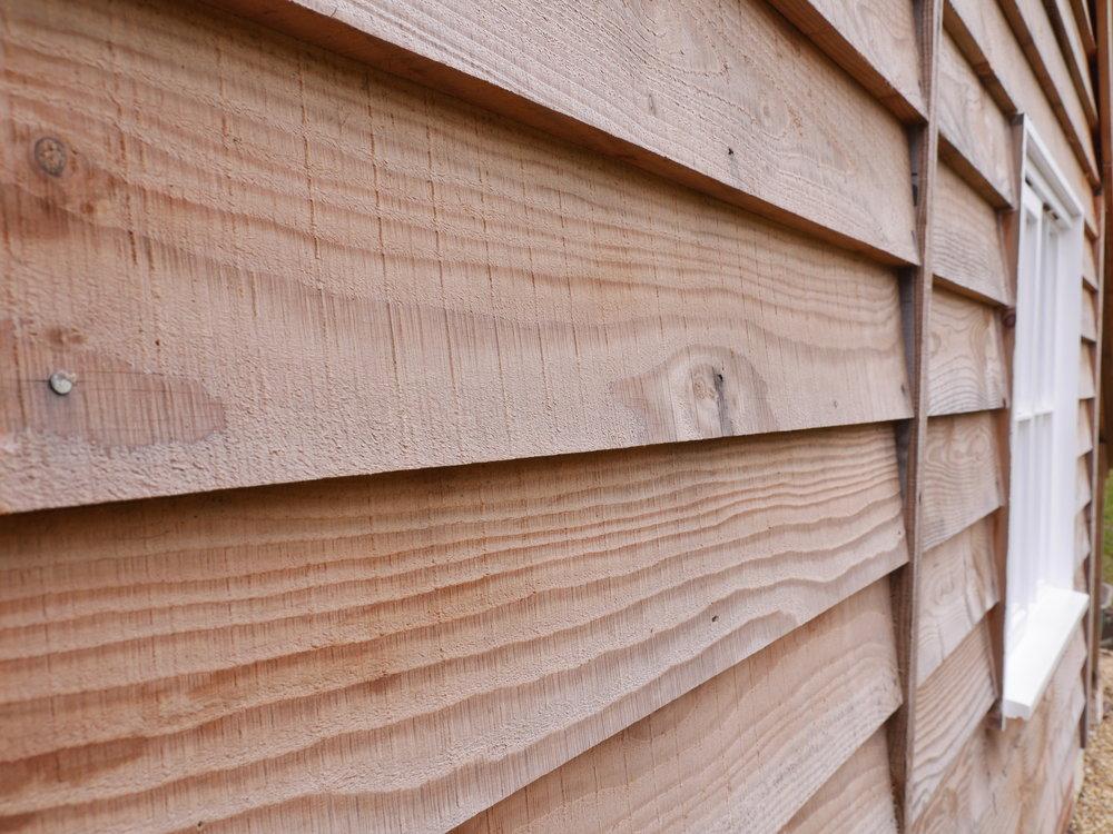 douglas fir feahteredge on a timber garage