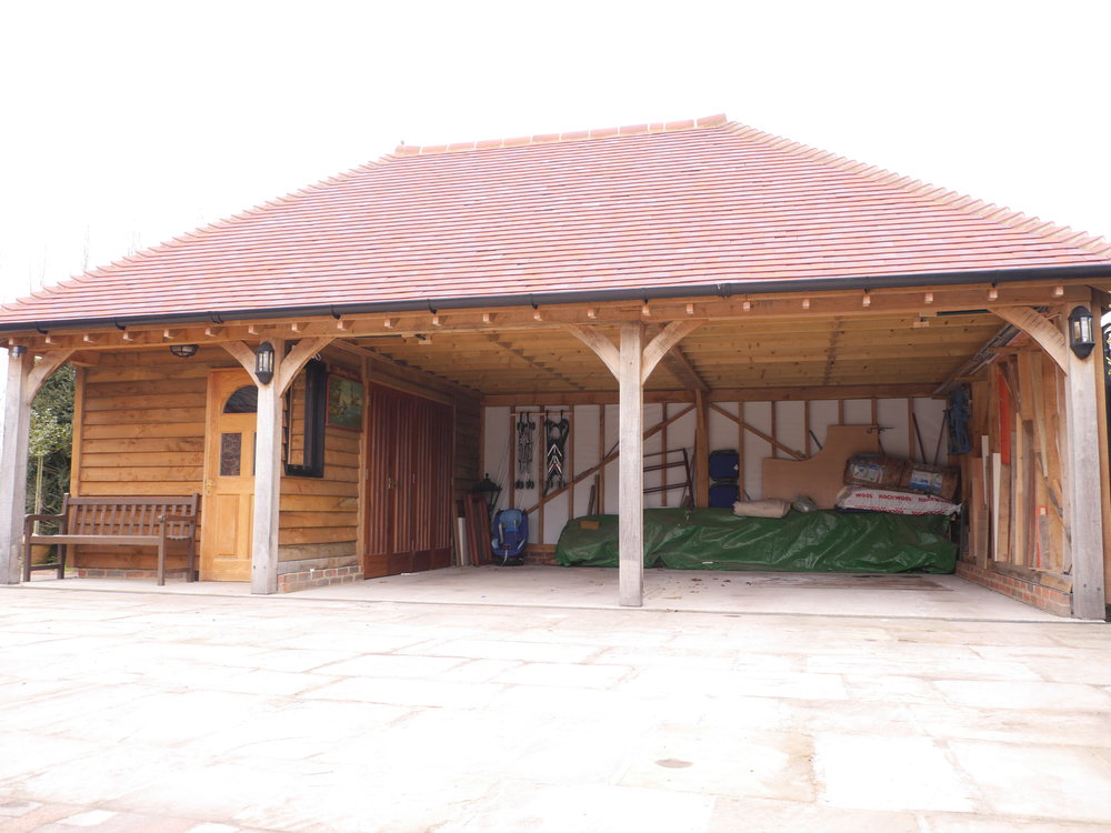 hipped roof oak garage and timber frame workshop