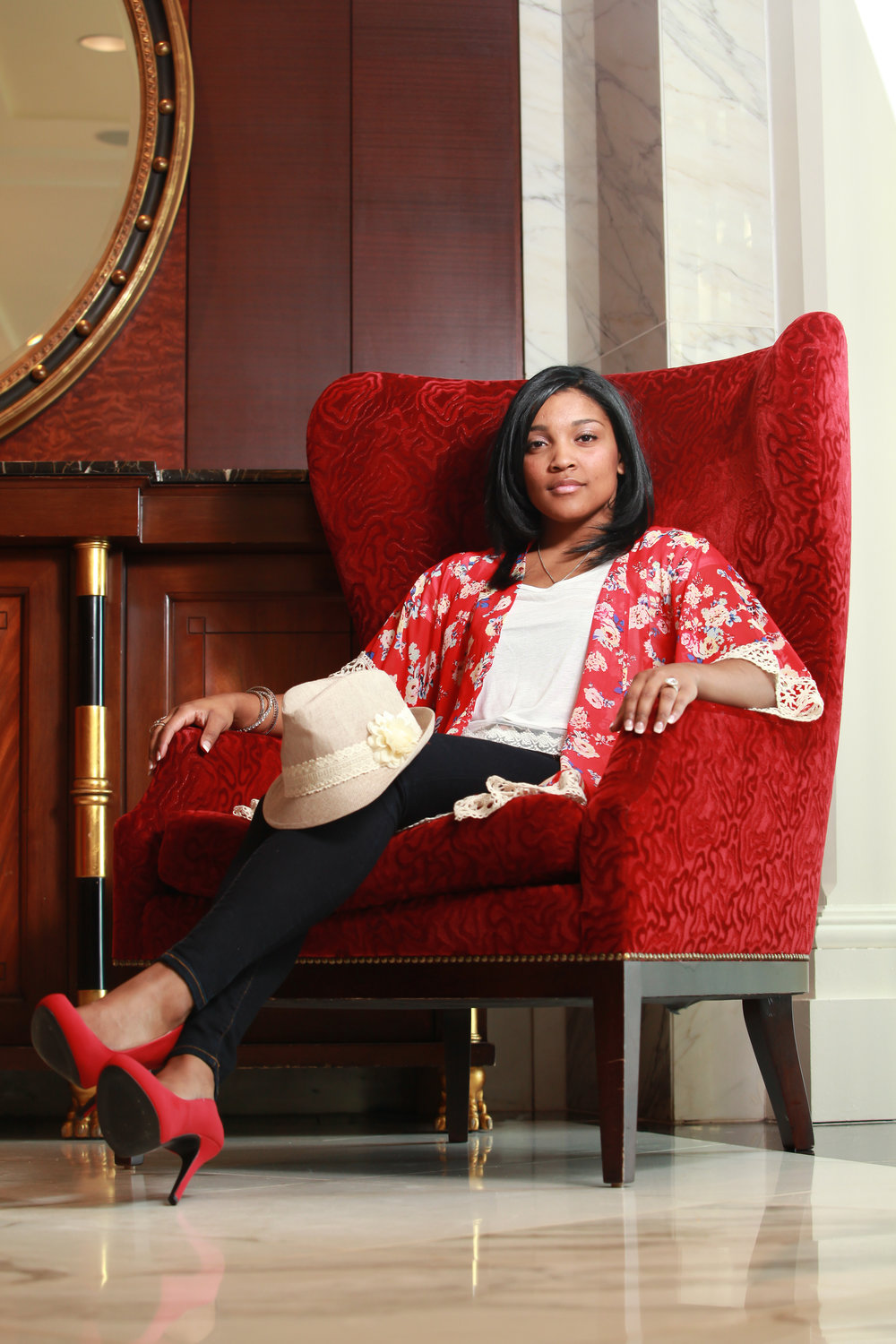 Janai in a red chair