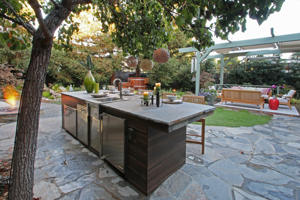 Japanese Garden - Pacific PalisadesIsland for entertainingHot TubStreamOutdoor living area with heater & Roman shadeFire feature