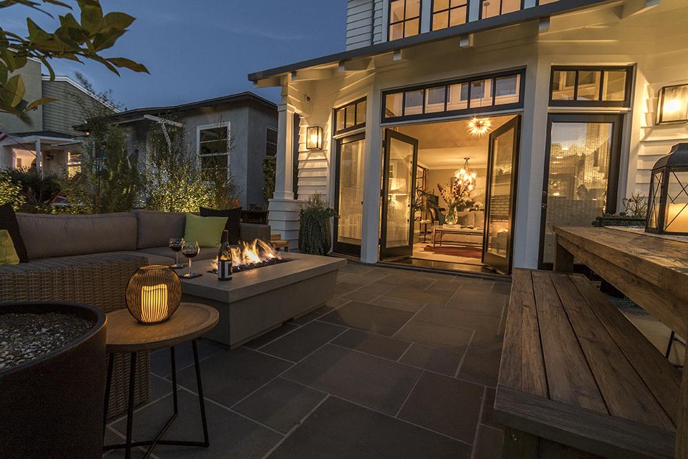 Walk Street Retreat - Manhattan BeachFire TableRustic tableWater permeable tile patioElegant lightingPrivacy planting
