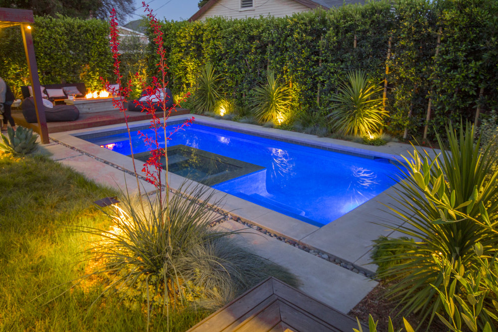 Lush Exterior - Los AngelesPool with built in spaFire tablePergola & outdoor diningDeck and BBQNative grasses
