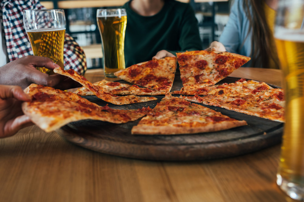Close-up-cropped-image-group-of-friends-having-pizza-in-cafe-823797074_7360x4912.jpeg