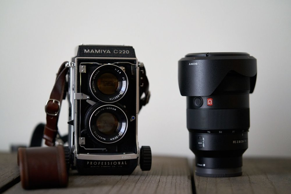 Comparing the size of the Mamiya C220 with the Sony FE 24-70mm f/2.8 GM lens