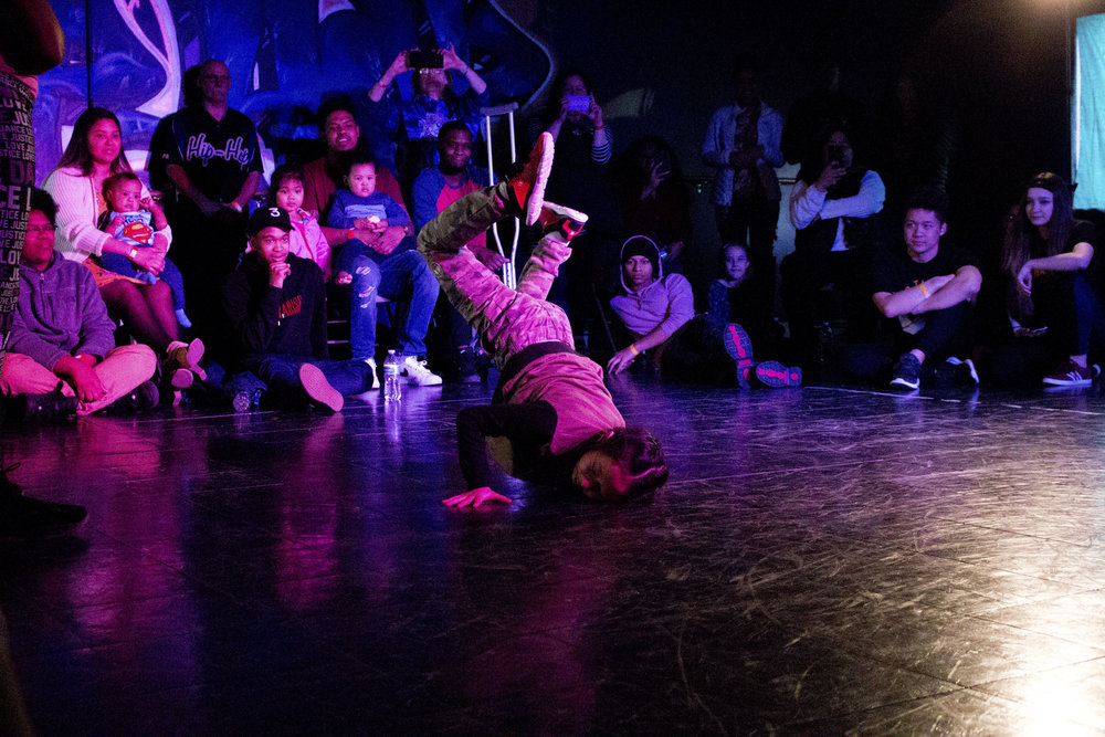 A young hip hop dancer showcases a break dance freeze at Underground Dance Company's Room 100 Vol. 8 event. The dance events are hosted every month. Photo credit: Mizelle Mayo