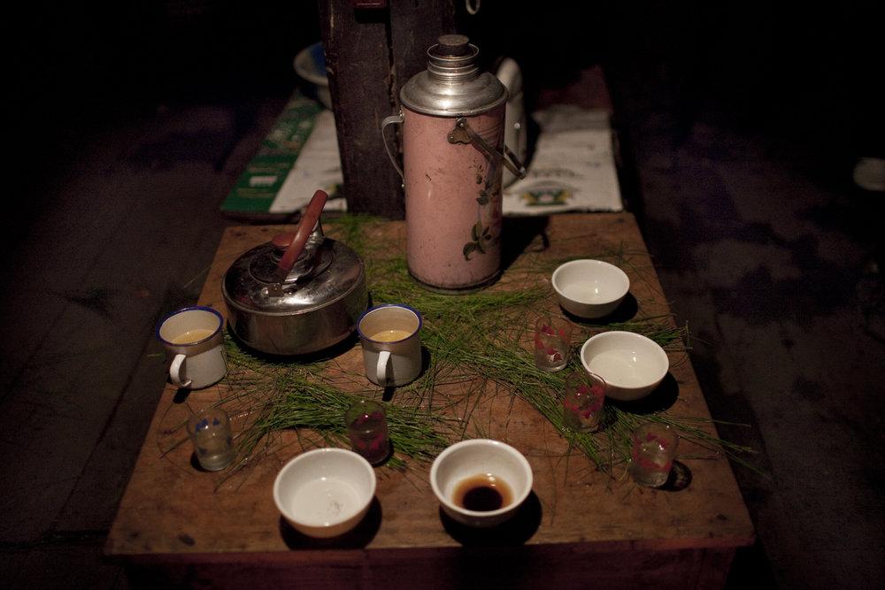 Qiunatong Village, Yunnan. After midnight mass villagers go home to start celebrating by dancing and drinking local spirits.