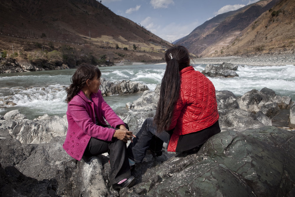 This site just north of Liuku is in the catchment of what might be another large dam along the river. These two women are from the only relocated village. When the dams were still being built their village was relocated off the river to new town away from their fields.