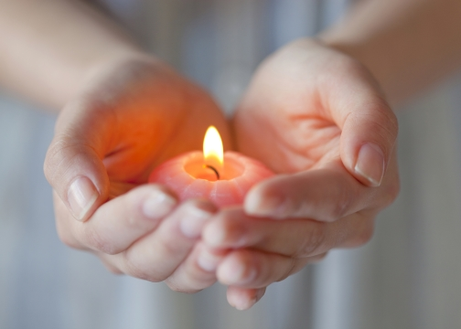 Woman hand holding a candle