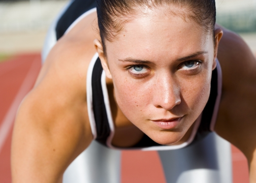 Determined woman prior to starting on race track