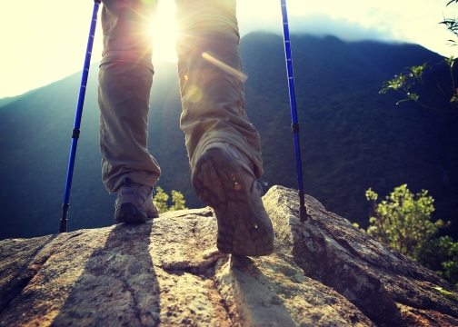 Woman hiker legs on hiking trail