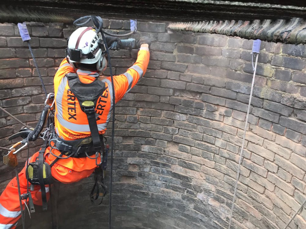 Rope Access Mechanical Rake Out and Repointing Brickwork in Railway Shaft