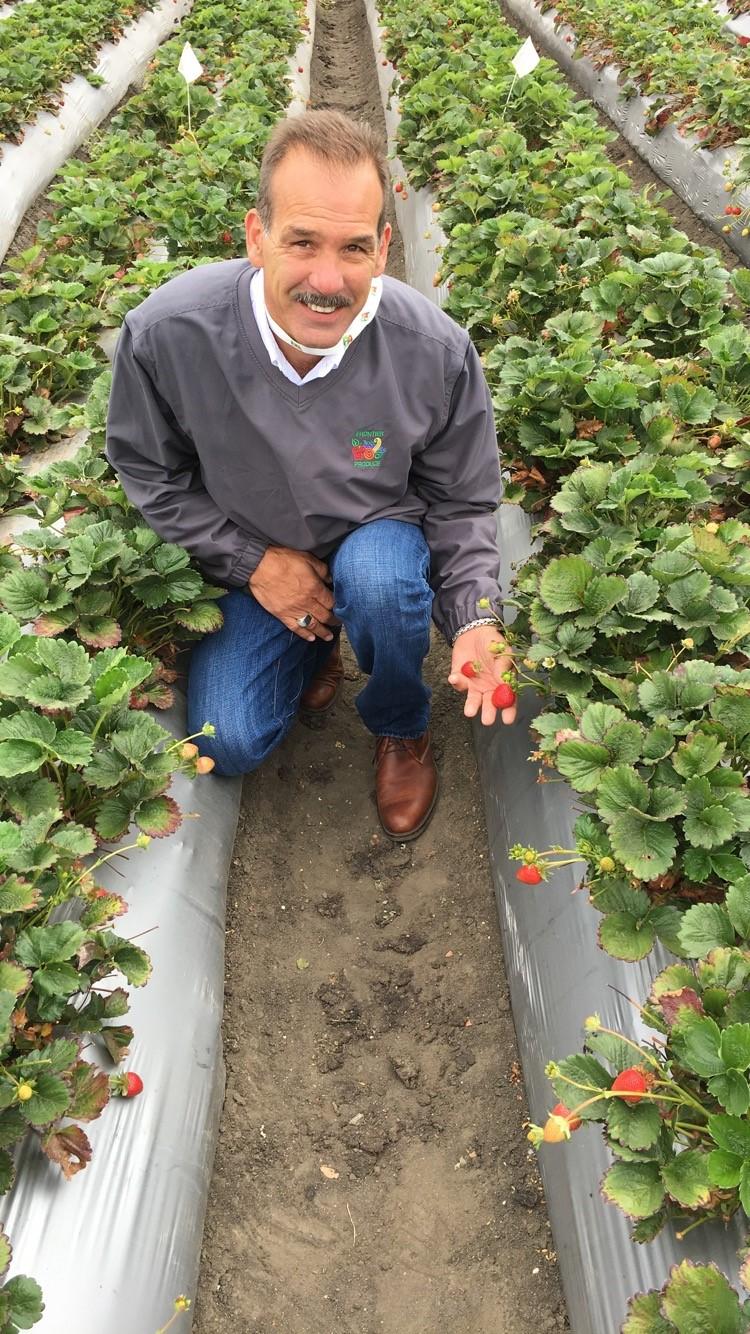 Rob Holding a strwberries.jpg