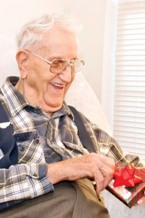 elderly-man-opens-gift.jpg