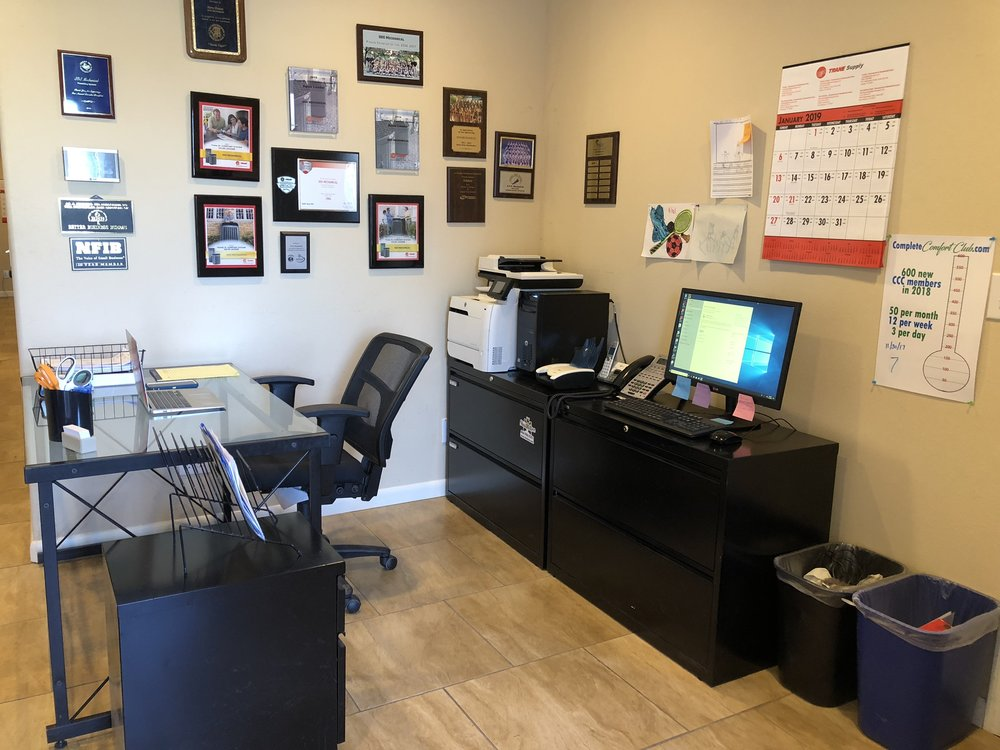 AFTER - We found a new home for the marketing materials that were cluttering up her work space and did some major rearranging to create an open, functional work space.