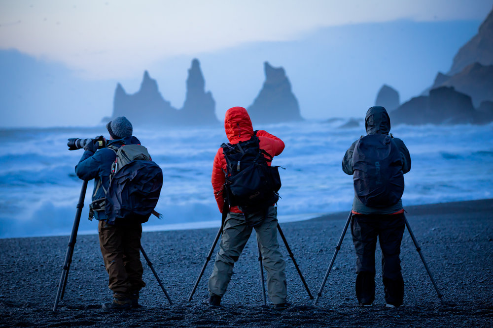 Photographing the sea stacks on the beach in Vik.