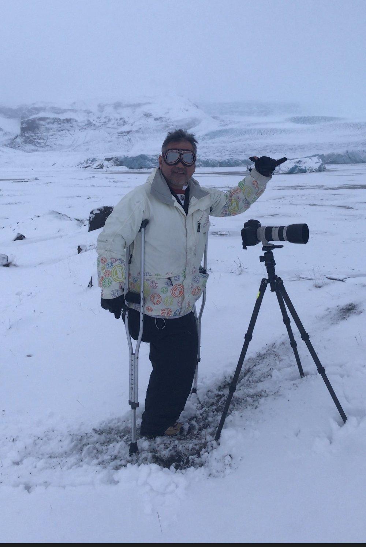 Erno grabbing some telephoto shots of a glacier.