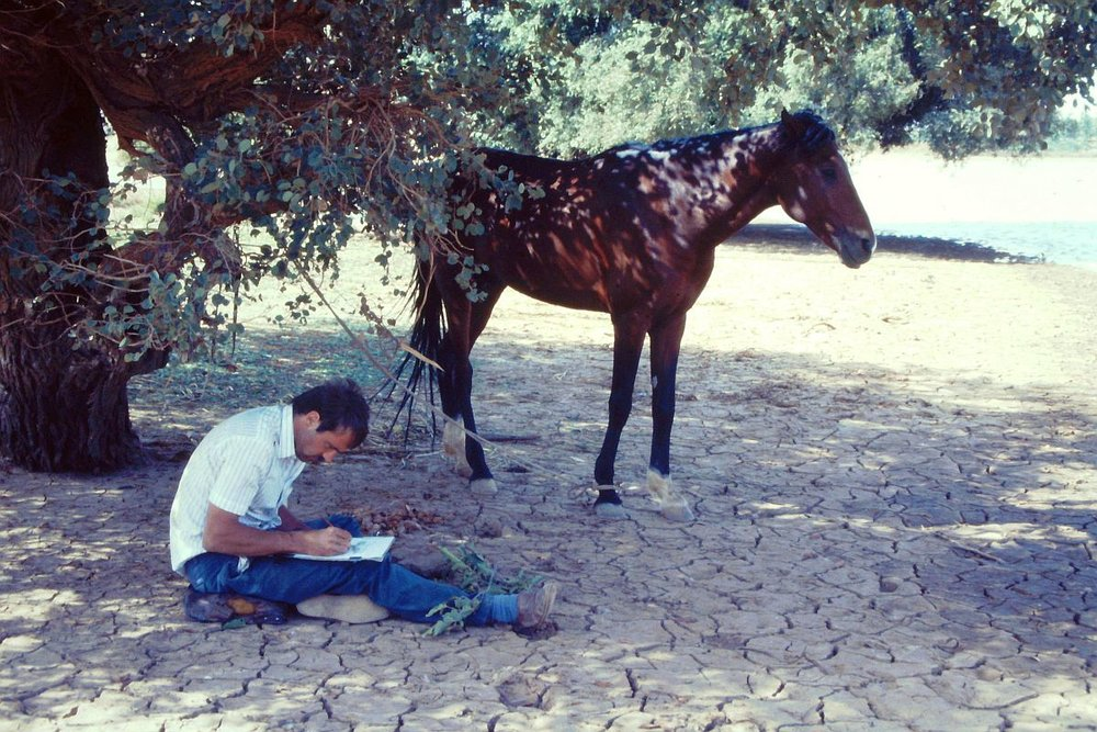 Thomas Berger with his horse, working on a botanical sketch in a wetland in Niger in 1987.