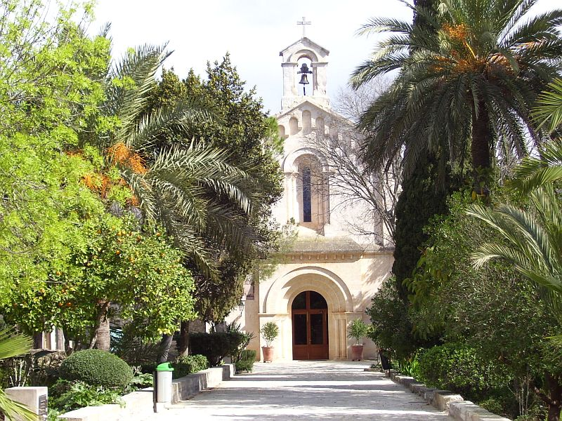 This small church has a beautiful garden with palms, fruit, ornamental trees, perennials, and herbs.